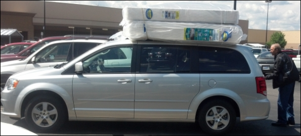 My Dad and I loaded components of my new bed on top of the minivan my parents rented